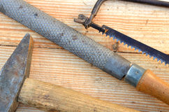 Old saw, rasp and hammer Stock Image