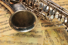 Old saxophone and notes Stock Image