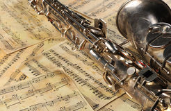 Old saxophone and notes Stock Photos