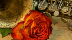Old saxophone with roses Royalty Free Stock Photo