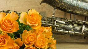 Old saxophone with roses Royalty Free Stock Images