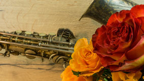 Old saxophone with roses Stock Photography