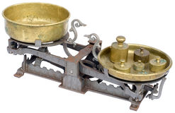 Old scale cutout. Old balance scale isolated on white background Stock Images