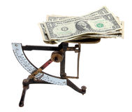 Old scale with dollar notes Stock Photography