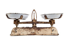 Old scales. Against  white background Stock Photos