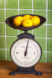 Old Scales with Lemons Royalty Free Stock Photos