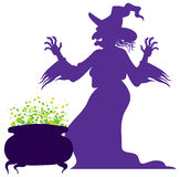 Old scary witch with magic cauldron Royalty Free Stock Image