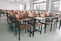 Old scattered chairs in the classroom.Student chair stock photo
