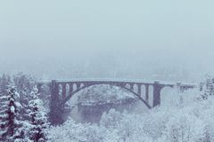 Old scenic bridge view in a winter landscape Stock Photos