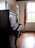 Old School. Old piano and American Flag in one room school house Stock Photo