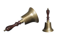 Old school bell or hand bell made of brass with wooden handle is Royalty Free Stock Photography