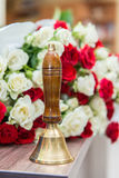 Old school bell with yellow flowers. Last call, graduation Royalty Free Stock Photo
