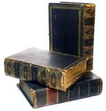 Old School Books. Antique Books stacked oddly on the table Stock Photography