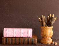 Old School Books And Wooden Pencils Royalty Free Stock Photography