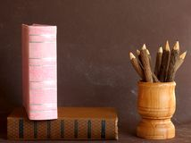 Old school books and wooden pencils Stock Images