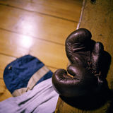 Old school boxing gloves on a bench Royalty Free Stock Image