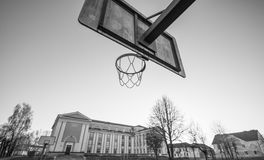 Old school building, and basketball hoop black and white potography Royalty Free Stock Images