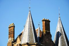 Old School Building, Coventry. Old school building spires and chimneys at St Mary Priory Gardens, Coventry, West Midlands, England, UK, Western Europe Royalty Free Stock Images