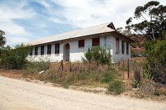 Abandoned old school building in disrepair. Old school building in disrepair in Voorbaat, Ladismith, Western Cape, South Africa Stock Image