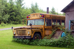 Old School Bus. Sitting in its final resting place stock image