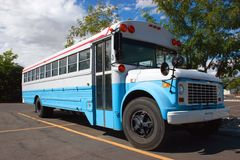Old school bus. An old school bus in blue and white Royalty Free Stock Photography
