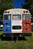 School bus converts into a camper. An old school bus has been painted red, white, and blue as it was connverted into a patriotic camper Royalty Free Stock Images