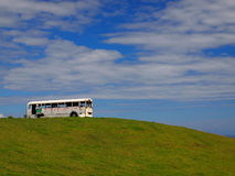 Old school bus on hilltop. Old bus taking the scenery in from the top of a hill Royalty Free Stock Image