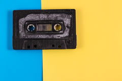 Old school cassette on a pop art background. Bright background and old grunge cassette stock image