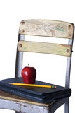 Old School Chair with Laptop, Apple and Pencil Royalty Free Stock Photography