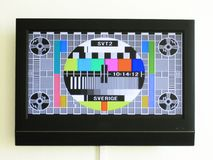 Colourful swedish test card on a modern television in front of a white wall royalty free stock photo