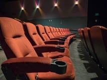 Old school empty movie theater with orange seats royalty free stock photos