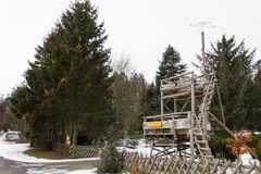 Old school forest authority watchtower in the forest in winter stock images