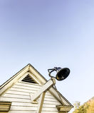Old school house with a bell. Old school house with a bell on a blue sky Royalty Free Stock Photos