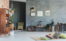 Old-school interior design. Old-school living room interior design with grey walls and wooden furniture Stock Photos