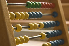 Old school maths. Colourful wooden abacus shallow depth of field, sharp to soft focus Stock Images