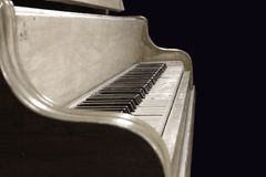 Old School Piano. An antique piano isolatedon a black background Royalty Free Stock Photo
