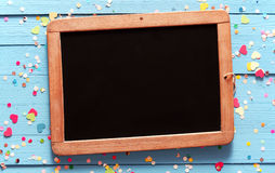 Old school slate with festive colorful confetti Stock Images