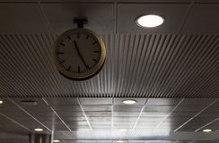 Old school style clock airport and train station ceiling clock royalty free stock photo