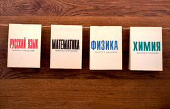Old school textbooks. Old textbooks on mathematics, physics, chemistry, Russian language isolated  in brown Stock Photos