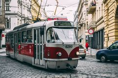 Old-school tram in Prague streets. Old-school tram in narrow Prague streets Royalty Free Stock Image