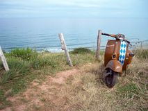 Old School Vespa in front of sea stock images