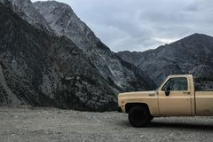 Old yellow Truck with a rocky dry Yosemite Park Valley in the Background stock photo