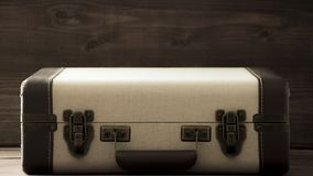 Old school vintage suitcase, beige and brown colours, sepia retro style journey and travel photo stock images