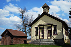 Old Schoolhouse. The old Cooksville, Wisconsin schoolhouse which is now the community center in Cooksville with a little brown shed next to it Royalty Free Stock Photo