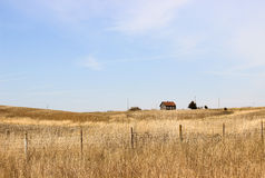 Old Schoolhouse. An old rundown country schoolhouse sits on a beautiful farm landscape in Iowa Stock Image