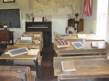 Old Schoolroom. An old schoolroom shows us the history of being here a long time ago. With slates and old books Stock Images