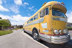 Old schools bus parked on the side of road Stock Photography
