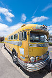 Old schools bus parked on the side of road Royalty Free Stock Photos