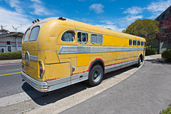 Old schools bus parked on the side of road Royalty Free Stock Photo