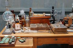 Old science lab with chemical reagents and burner.  royalty free stock images